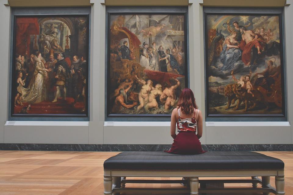 Blog image of woman sat in art museum